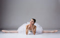 Female ballet dancer beautiful on a grey background ballerina is wearing a white tutu and pointe shoes Royalty Free Stock Photography