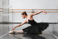 Female ballet dancer posin on rehearsal Royalty Free Stock Photo
