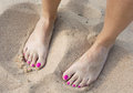 Female bare feet in the sand yellow Royalty Free Stock Photography