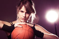 Female basketball player holding ball Stock Image
