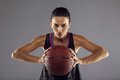 Female basketball player passing the ball portrait of happy beautiful young woman in sportswear holding looking at Stock Photo