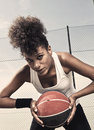 Female basketball player portrait of a street basket holding the ball Royalty Free Stock Photos