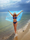 Female at the beach holding sarong Stock Photography