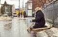Female beggar on the street