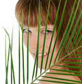 female behind palm leaf over white Royalty Free Stock Photo