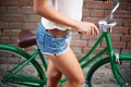 Female bicyclist close up of young woman with bicycle Royalty Free Stock Photo