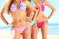 Female bodies in bikini on the beach Royalty Free Stock Photo