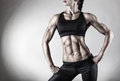 Female body the sports an attractive woman on gray background Royalty Free Stock Images