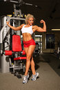 Female bodybuilder flexing muscles Royalty Free Stock Photo
