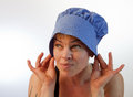 Female in bonnet this model is wearing a blue Stock Image