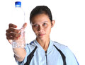Female with a bottle water ii in sport attire of mineral Royalty Free Stock Photo