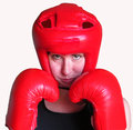 Female boxer isolated a wearing red boxing gloves and head guard ready to fight on white Stock Photos