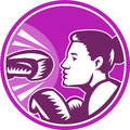 Female boxer punch retro illustration of a woman about to dodge a knockout set inside circle done in woodcut style Royalty Free Stock Photography