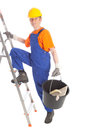 Female builder with bucket and ladder Stock Images