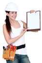 Female builder with a clipboard Stock Image