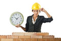 Female builder and clock Stock Images