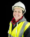 Female builder smiling construction worker wearing helmet and high visibility vest Royalty Free Stock Photos
