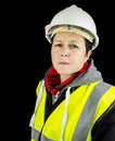 Female builder unhappy wearing vest and safety helmet Stock Photography