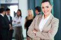 Female business executive attractive with arms crossed in boardroom Royalty Free Stock Photography
