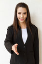 Female business executive offering hand shake greeting with Royalty Free Stock Photo