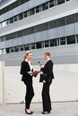 Female business executives outside offices Stock Photography