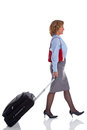 Female business woman with travel suitcase a businesswoman walking along pulling a isolated on white background Stock Photos
