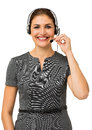Female call center representative talking on headset portrait of against white background vertical shot Royalty Free Stock Photos