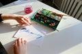 Female calligrapher creates inscription for sale, using brushes