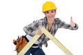 Female carpenter with truss a wooden Stock Images