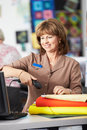 Female cashier at clothing store scanning clothes Stock Photos