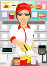 Female cashier at fast food restaurant returning a credit card Royalty Free Stock Photo