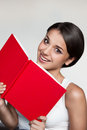 Female in casual outfit holding red book Stock Photography