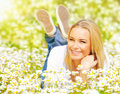 Female on chamomile field Royalty Free Stock Photo