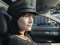 Female chauffeur driving a car closeup of in uniform Royalty Free Stock Photography