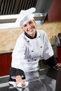 Female chef cleaning Royalty Free Stock Photo