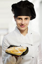 Female chef with lemon tart confectioner Stock Images