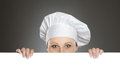 Female chef looking over  billboard Royalty Free Stock Images