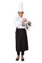 Female chef with tray of food in hand