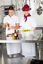 Female chefs preparing food in kitchen two restaurant Stock Photography
