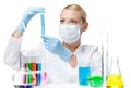 Female chemist in respirator holds a vial Royalty Free Stock Photos