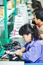 Female chinese worker in factory Royalty Free Stock Photo