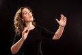 Female choir conductor during performance Stock Photography