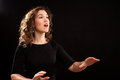 Female choir conductor during performance Royalty Free Stock Photos