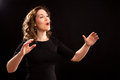 Female choir conductor Royalty Free Stock Photo