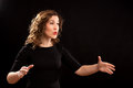 Female choir conductor during performance Royalty Free Stock Images