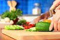 Female chopping food ingredients. Royalty Free Stock Photo