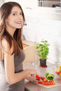 Female chopping food ingredients Royalty Free Stock Images
