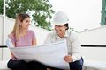 Female client with architect young discussing house plan male Royalty Free Stock Photo