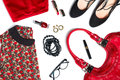 Female clothes look essentials in red and black silk blouse skirt high heels leather bag lipstick glasses Stock Photo