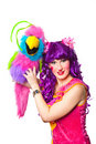 Female clown with colorful toy bird Royalty Free Stock Images
